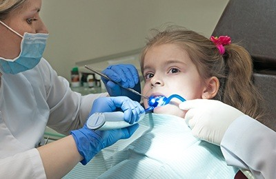 girl getting fluoride treatment