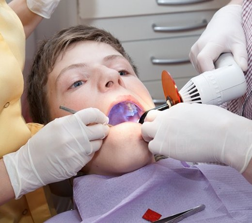 little boy getting dental sealants in Brownstown