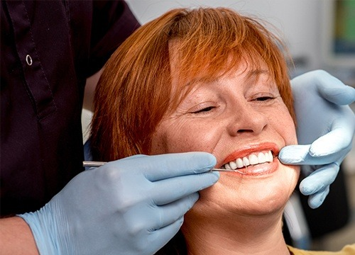 dentist showing woman her smile