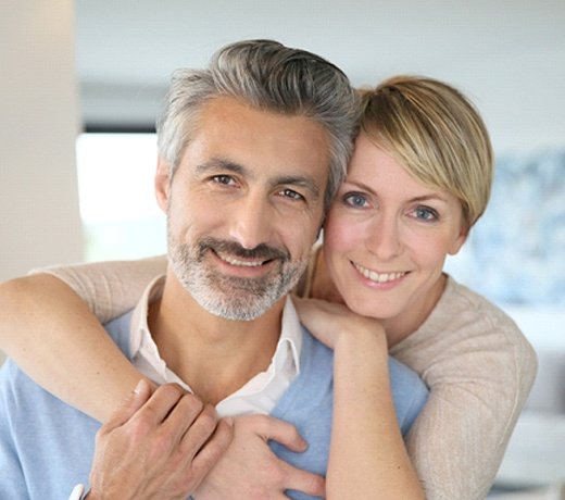 Happy couple with dental implants