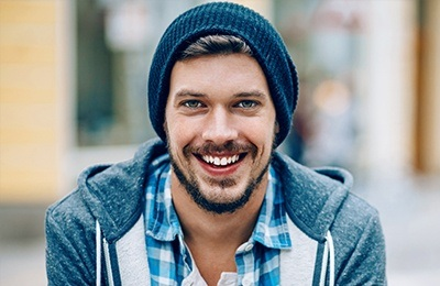 man with beanie smiling
