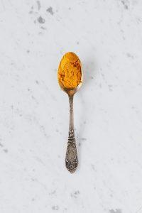 Turmeric on a metal spoon